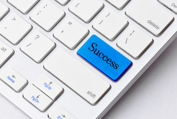 Close-up the  Success button on the keyboard and have Blue color