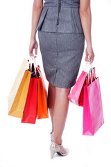 business women carrying colorful shopping bag isolated on white