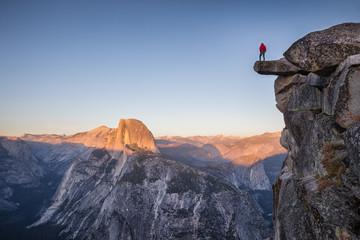 Hiker at Glacier Point at sunset, Yosemite National Park, California, USA Wall mural