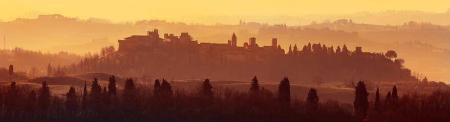 Historical village of Certaldo in foggy sunset, Firenze, Tuscany, Italy