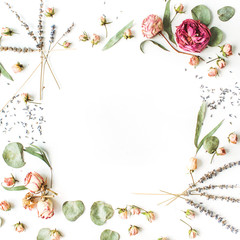 Frame of roses, lavender, branches, leaves and petals on white background. Flat lay, top view
