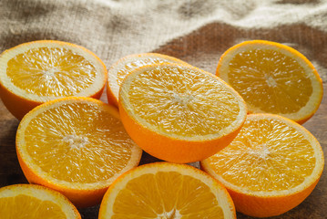 Oranges Fruits and Orange Slice on Wooden Table and Retro Fabric