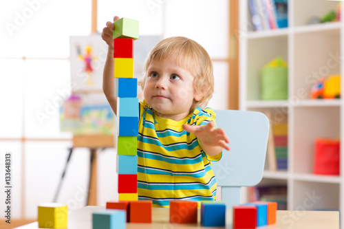 Toys For Day Care Centers : Quot child boy playing with block toys in day care center
