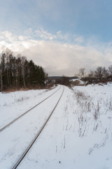 Snowy rails on the edge of town.