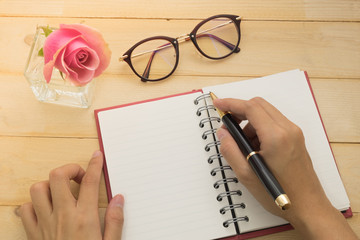 hand of women write on diary in valentine concept