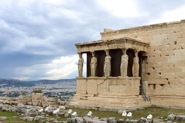 caryatids against dramatic sky, Athens