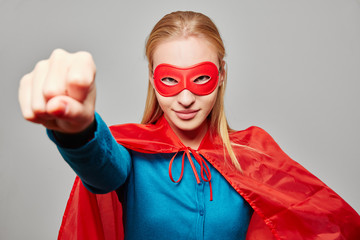 Woman dressed as a superhero with clenched fist