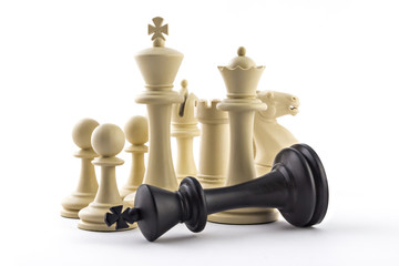 Chess business concept, leader & success. White figures and defeated black king