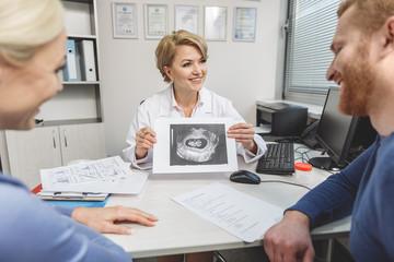 Happy doctor telling good news