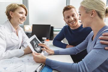 Happy female medical advisor working