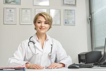 Smiling female medico doing her work