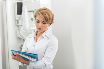 Female medical advisor absorbedly writing