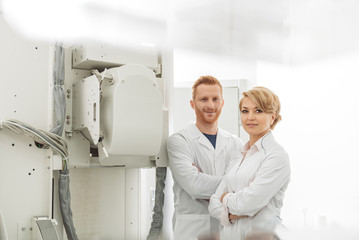 Confident doctors in x-ray room