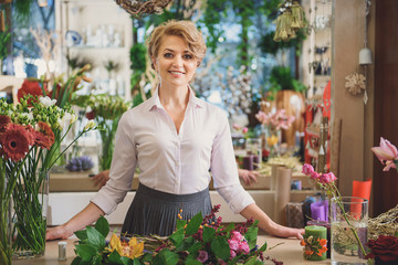 Happy woman working in flower shop