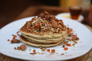 Pancakes and assorted nuts and seeds, close up