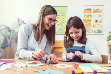 Mother with her child having creative and fun time