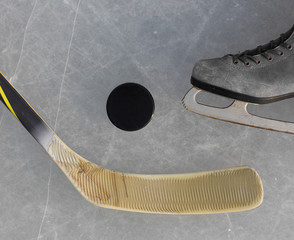 hockey stick, skates and the puck on the ice