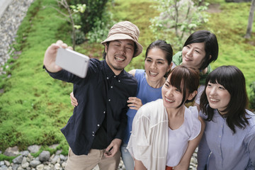 Group of Japanese tourists taking pictures
