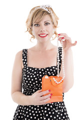 Pin up girl receiving a gift. Isolated on white background.