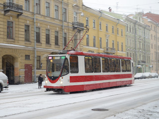 The tram is at the stop.