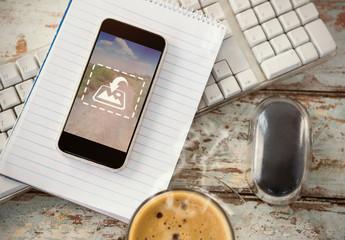 Smartphone on Desk with Notebook Mockup