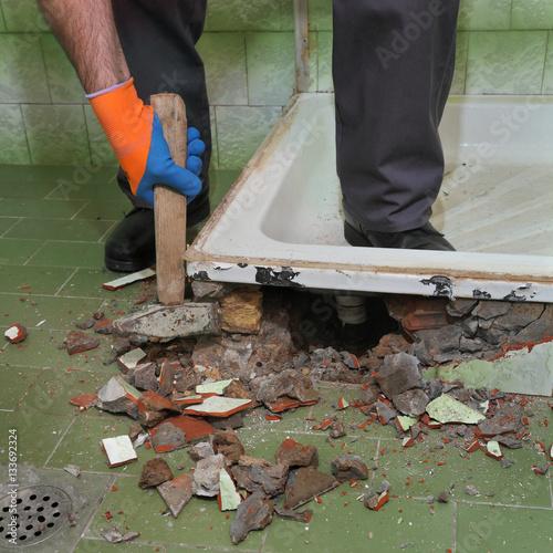 Quot home renovation worker demolish bathroom using hammer