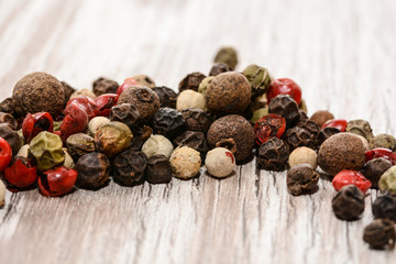 Set of whole peppercorns, handful of red, black, white peppercorns. Herbs and spices concept