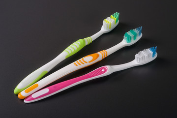 manual toothbrushes on the dark background top view