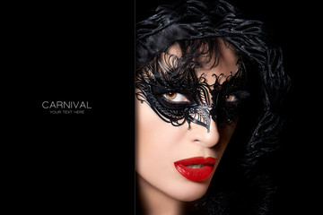 Sultry mysterious woman in carnival mask
