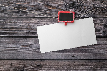 Blank greeting card over wooden background