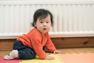 Cute Asian baby girl crawling on floor