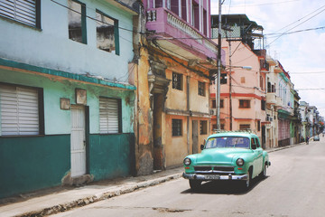 Vintage green car on street