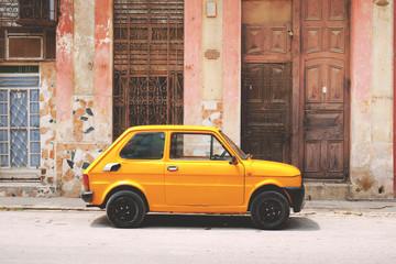 Vintage yellow car on street