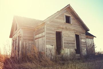 An abandoned dilapidated farmhouse.