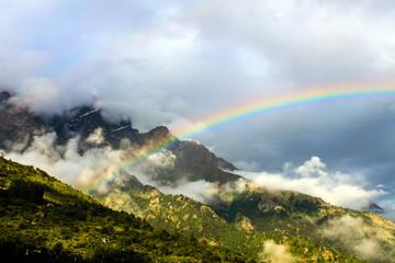 A rainbow over mountains.