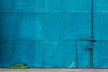 Blue metal building exterior with doors, Wellington City, Wellington, New Zealand