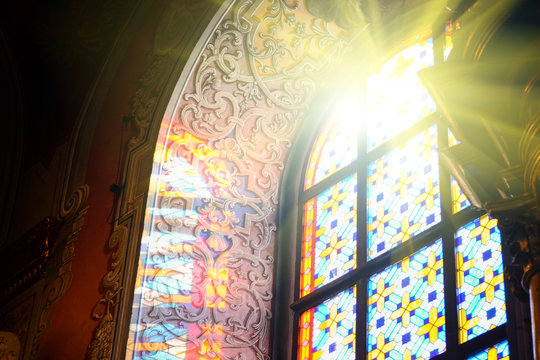 The Bernardine church and monastery (church of St. Andrew) in Lviv, Ukraine. Church and fortification was built in 1600-1630. Beautiful stained glass window with sunlight. Religion and art concept.