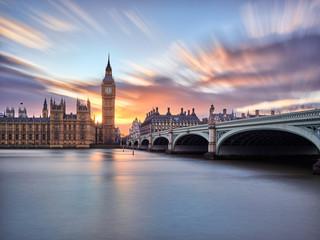 London Bridge and Big Ben during sunset in London, England.