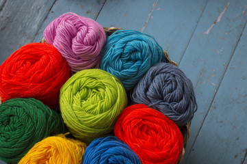 Colorful yarn wool for knitting in basket on table