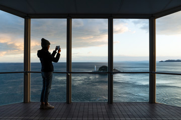 Silhouette of Woman taking photo