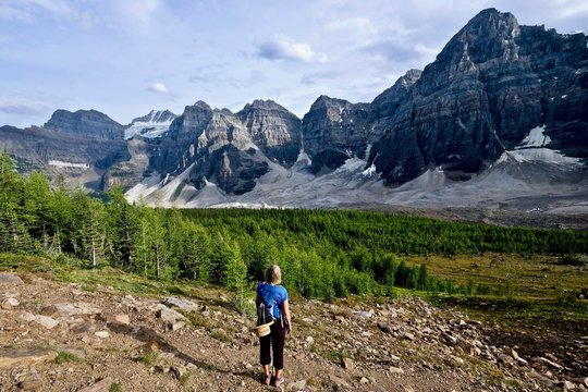 Woman hiking in Ten Peaks Valley. Valley of Ten Peaks. Banff National Park. Canadian Rocky Mountains. British Columbia. Canada.