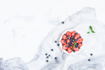 Fruit salad with strawberry and blueberry. Flat lay, top view