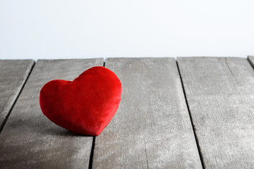 Red Heart Shape pillows on wooden background