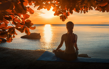 serenity and yoga practicing at sunset,meditation