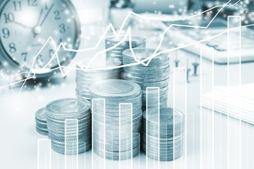 Double exposure of office and graph on rows of coins for finance and banking concept