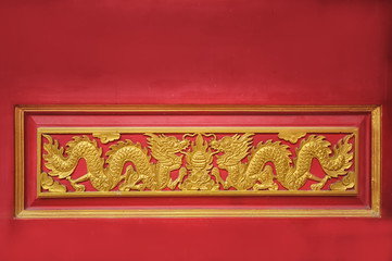 Golden dragon on red door background in Chinese temple