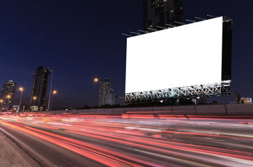 Blank billboard on light trails, street and urban in the twilight or night use for advertising product