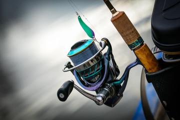 Fishing reel, blurred background.