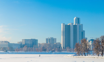 Embankment in Yekaterinburg winter on a sunny day