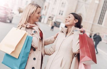 Young women shopping together. Consumerism and lifestyle